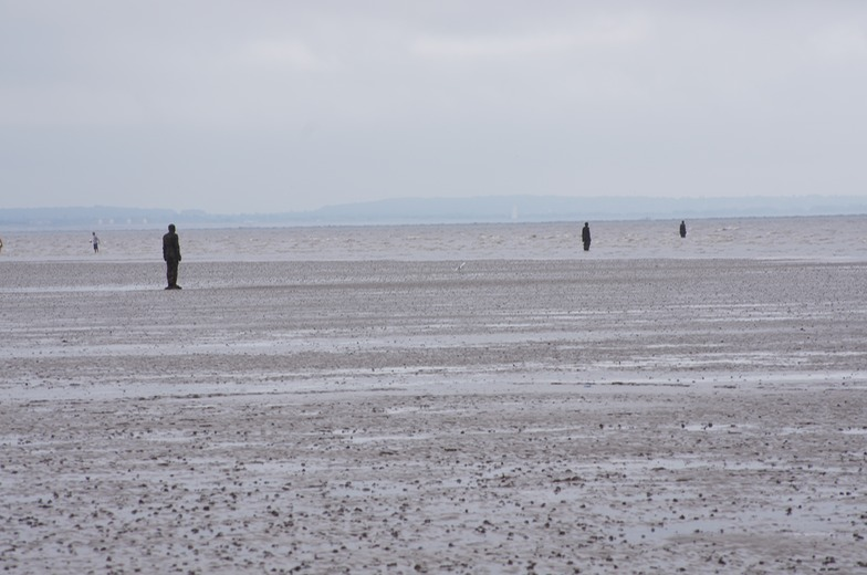 3 of Sir Anthony Gormley's 100 Statues at Crosby's Beach
